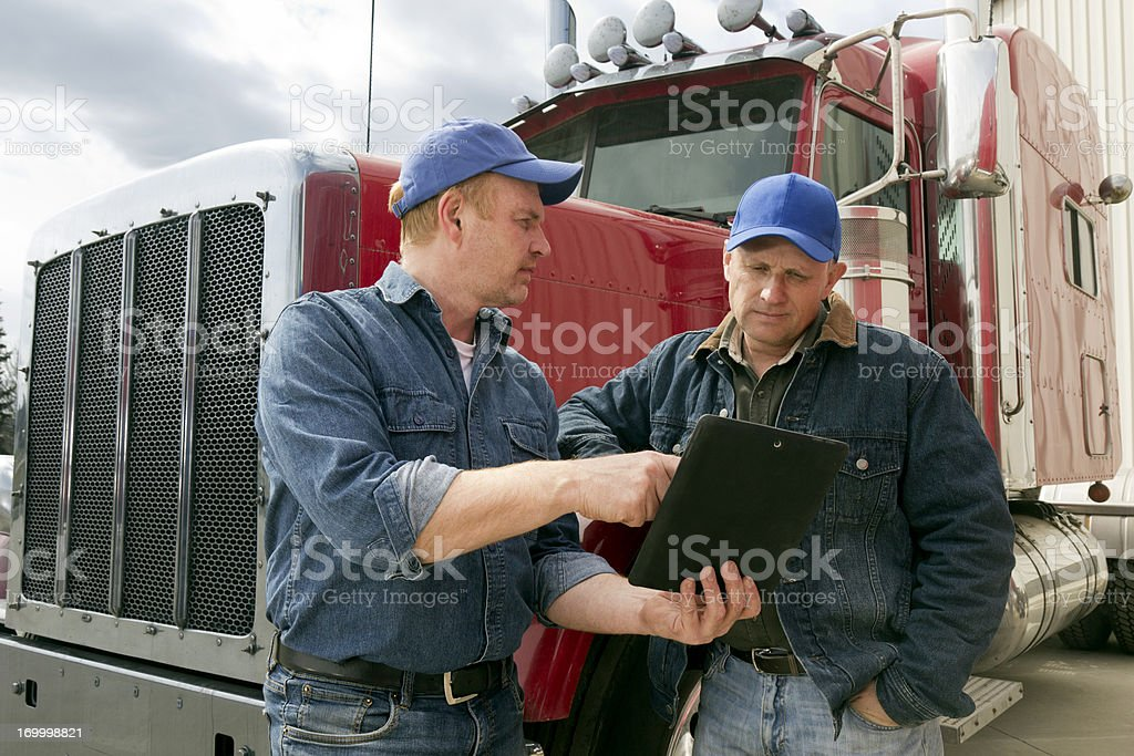 Truckers and Tablet stock photo