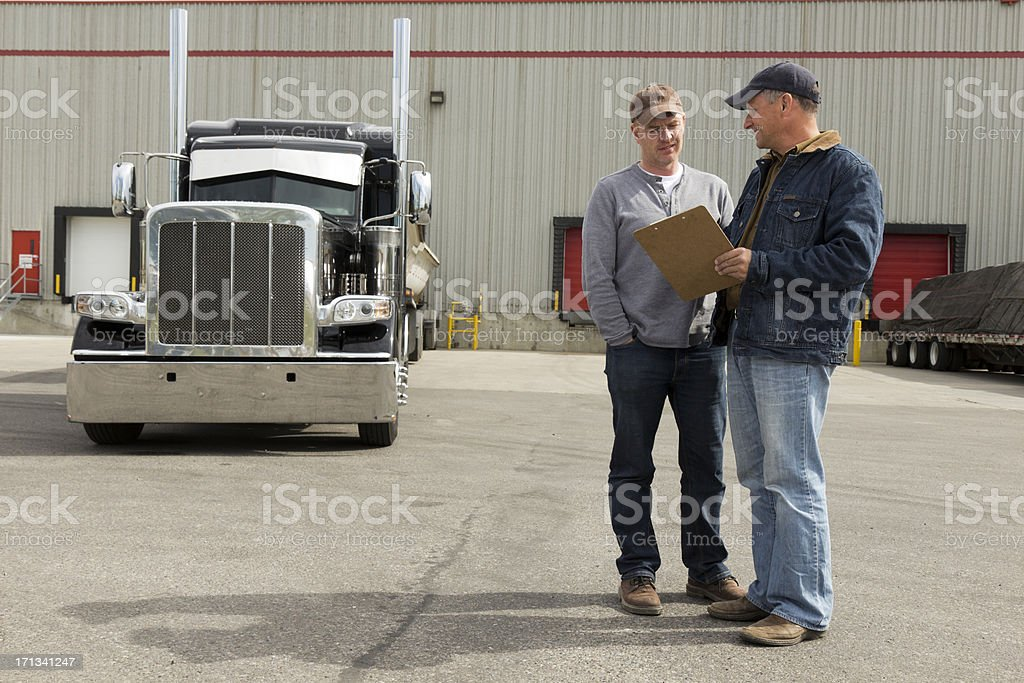 Truckers at a Warehouse royalty-free stock photo