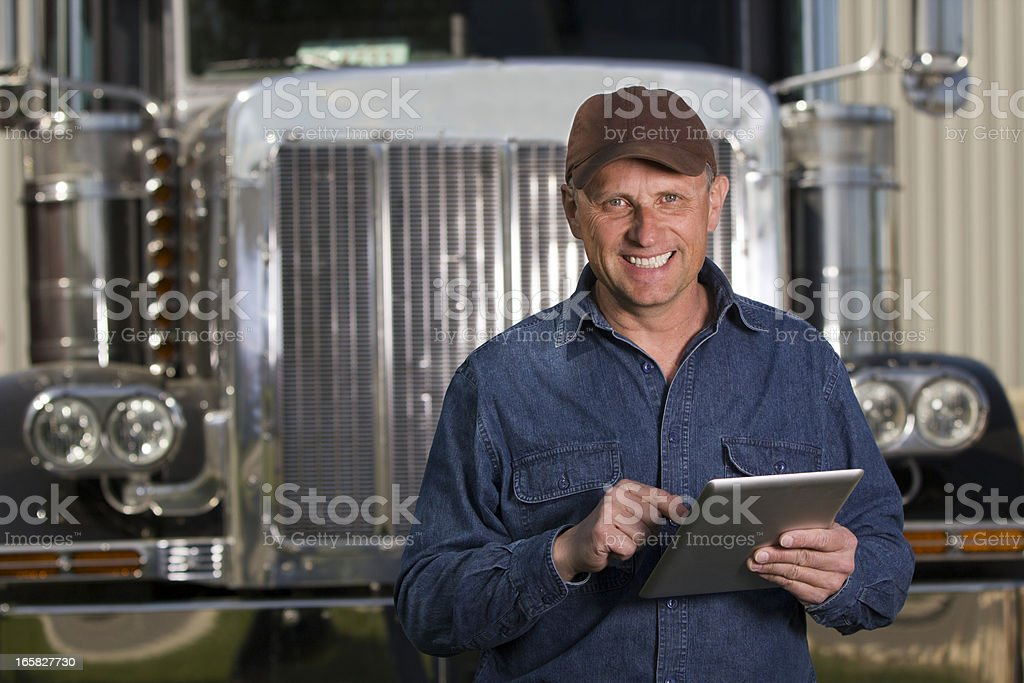 Trucking and Tablet royalty-free stock photo