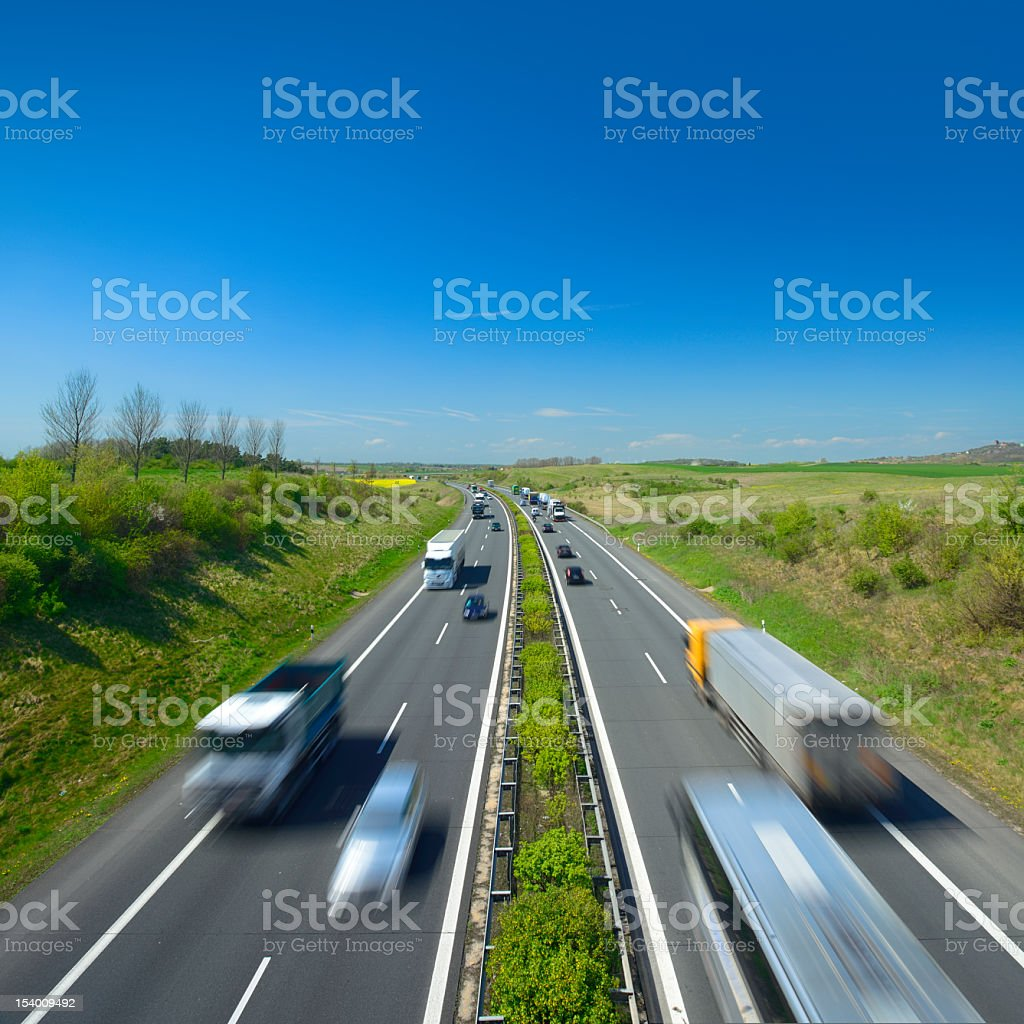 Trucks and Cars Driving on Motorway stock photo