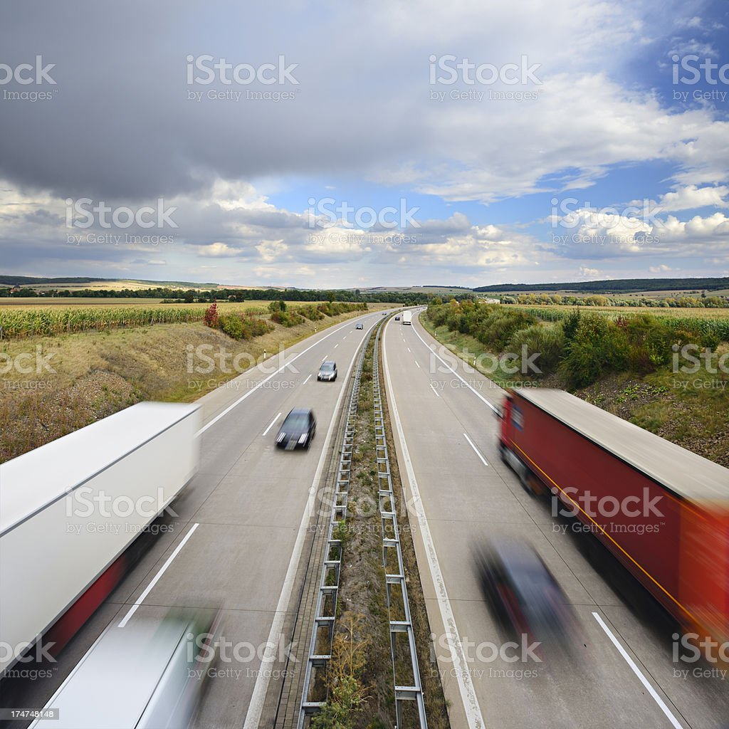 Trucks and Cars Driving on Motorway royalty-free stock photo
