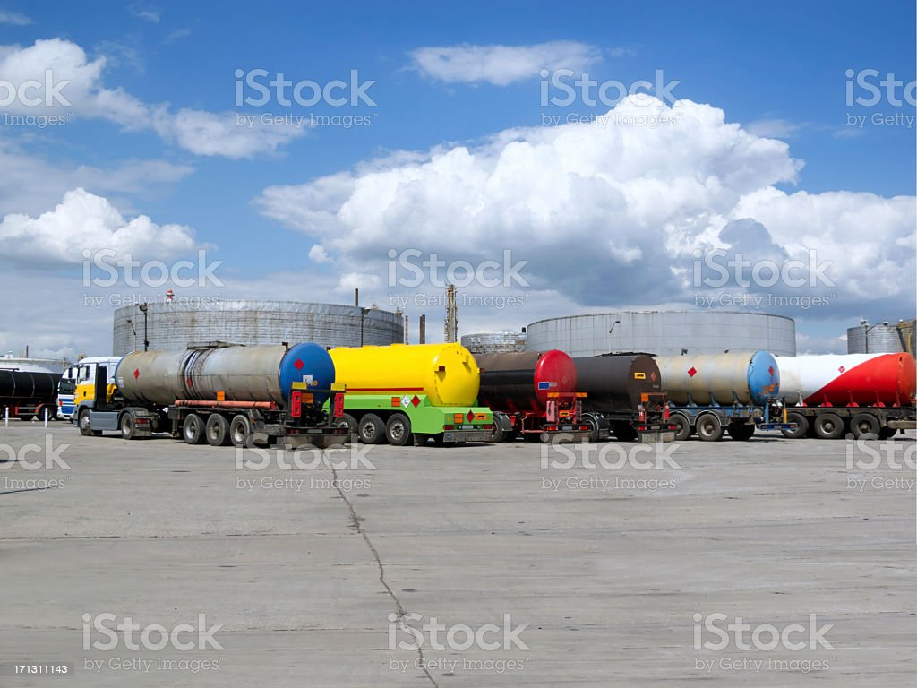 Trucks and oil refinery royalty-free stock photo