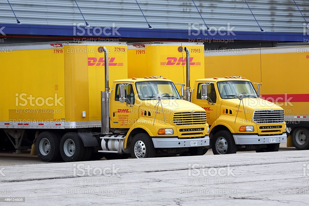DHL trucks at a distribution hub in Chicago stock photo
