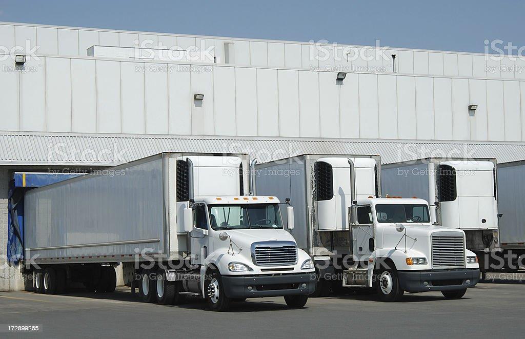 Trucks at loading dock stock photo