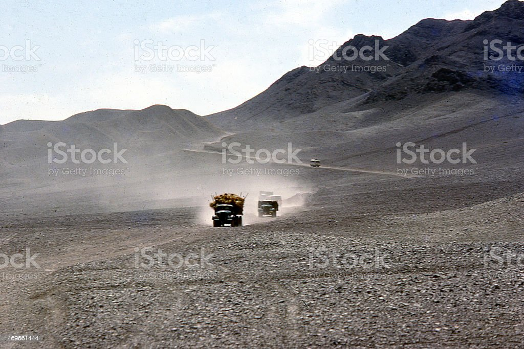 Trucks crossing Desert Pavement Landscape Road to Turpan Xinjiang China stock photo
