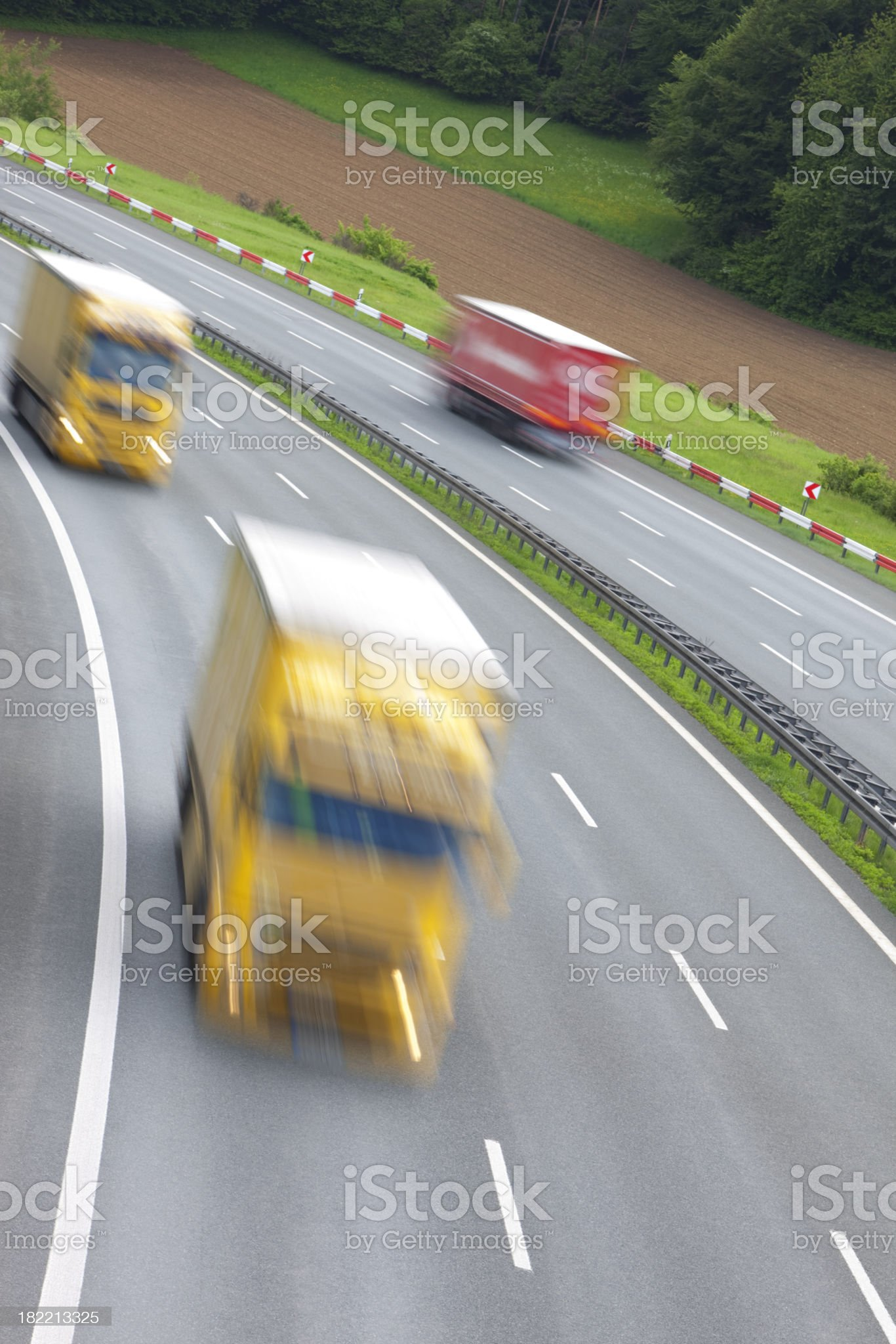 Trucks driving on highway, blurred motion, high angle view royalty-free stock photo