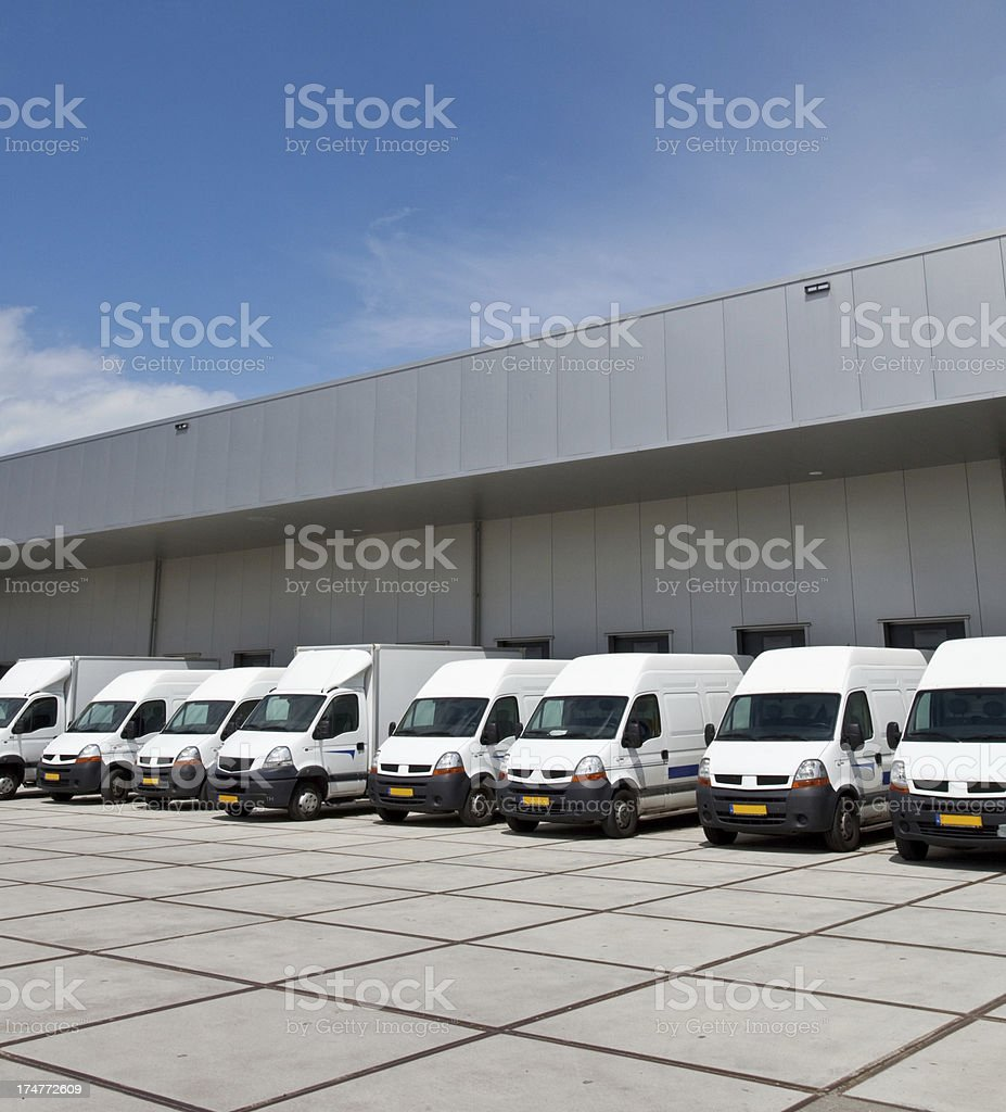 Trucks in front of a warehouse stock photo