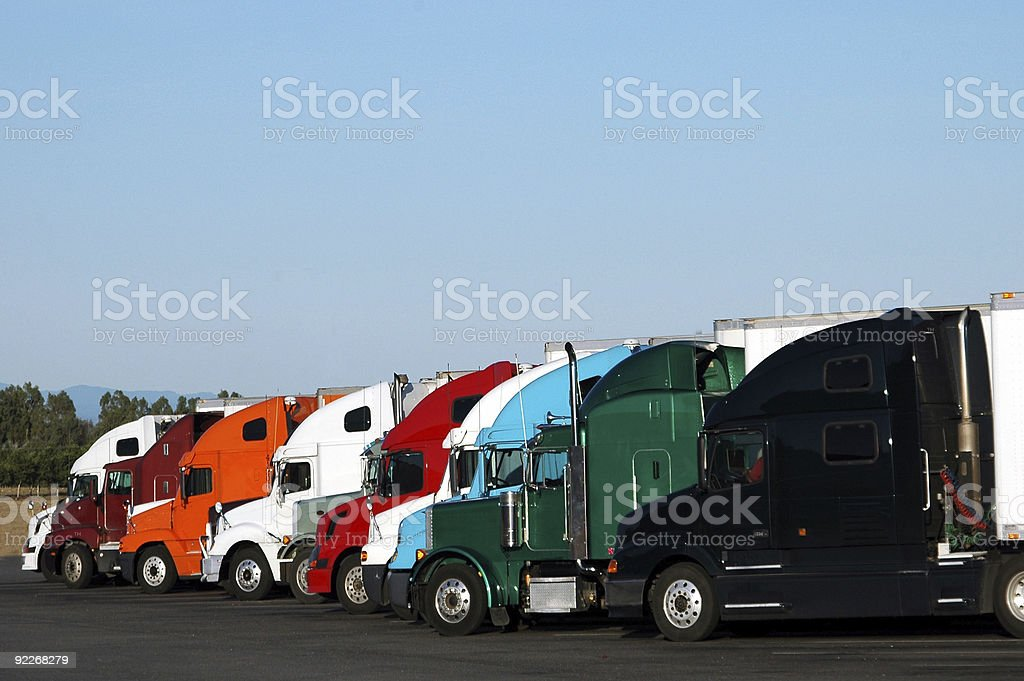Trucks of different colors parked in a line royalty-free stock photo