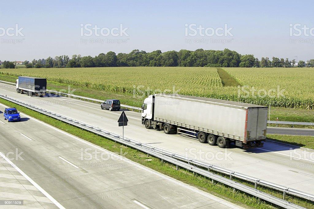 Trucks on highway stock photo