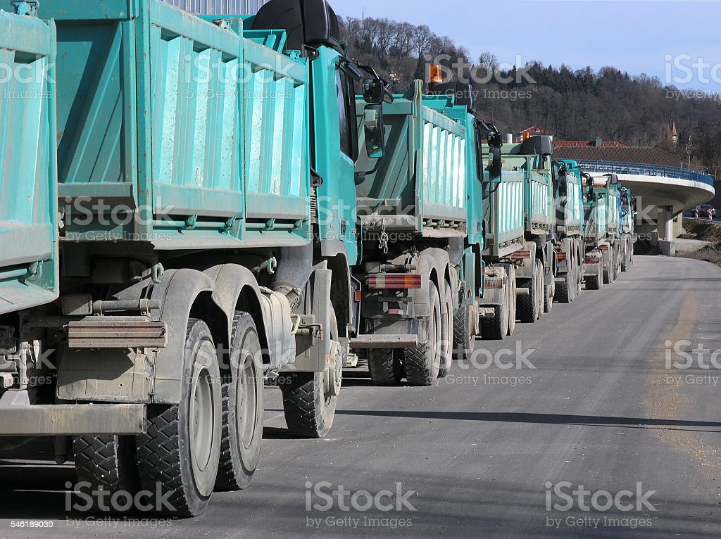 Trucks on road building stock photo