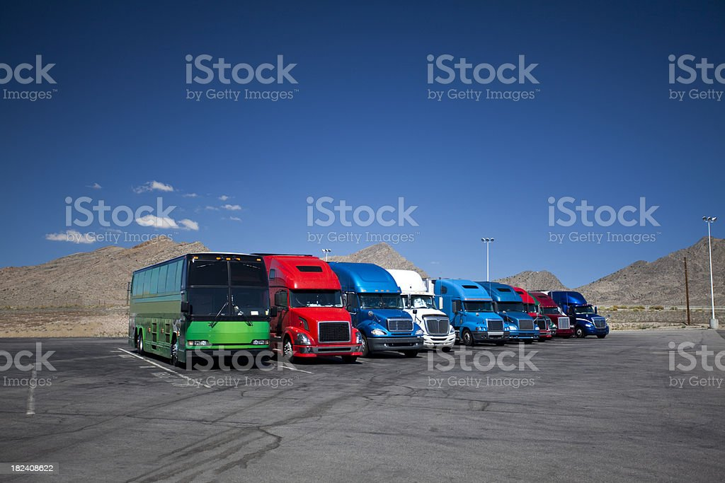 Trucks parked at a freeway truckstop stock photo