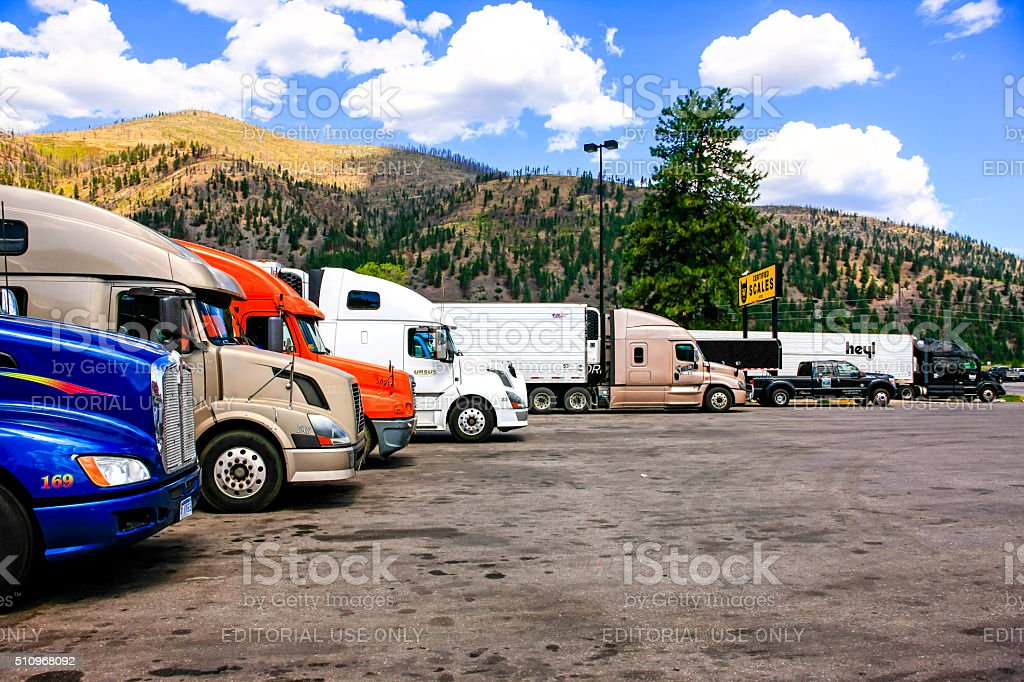 Trucks parked at a truck stop on I-90 in Montana stock photo