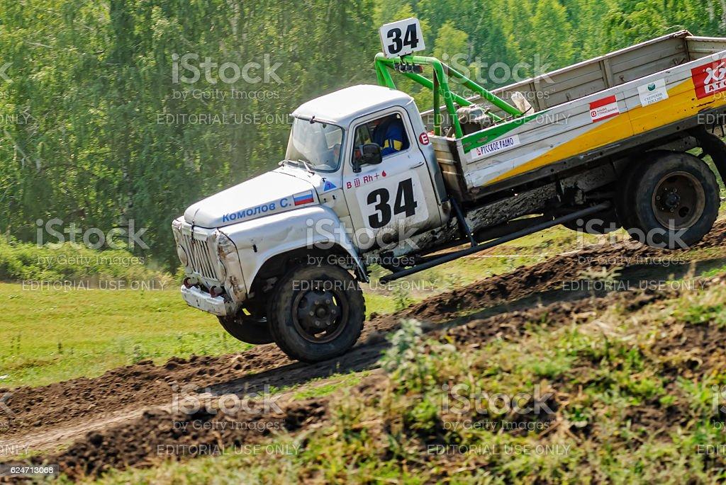 Trucks racing on unpaved track stock photo