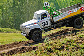 Trucks racing on unpaved track