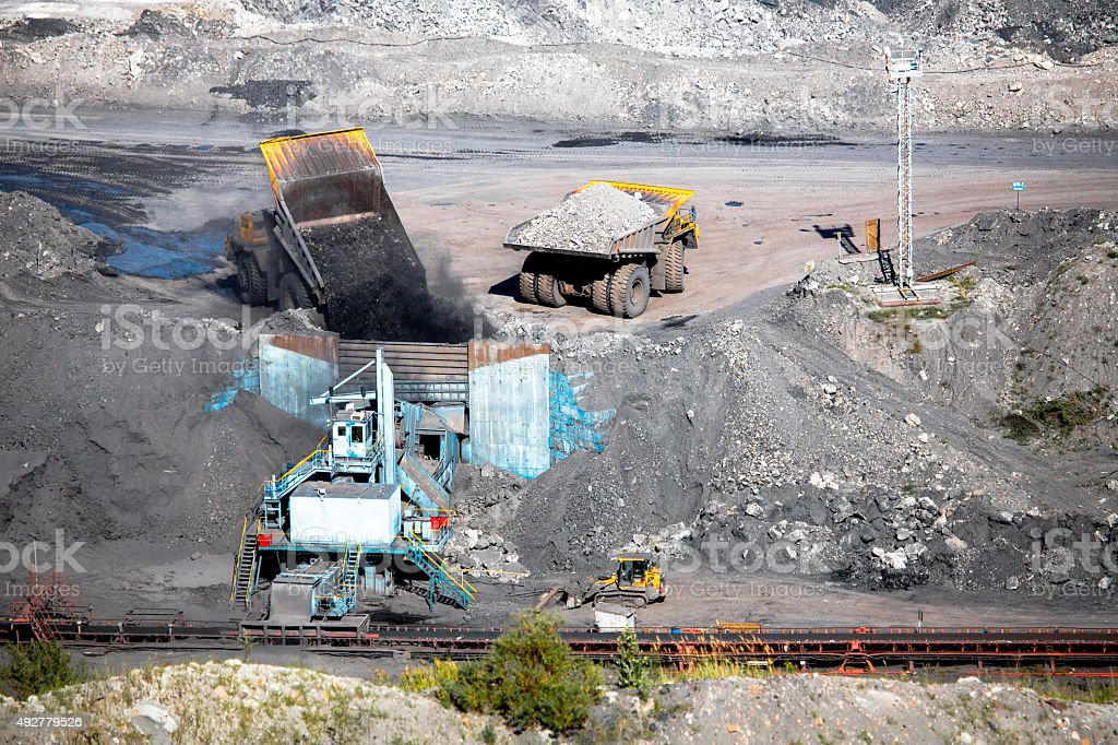 Trucks unloading in Pit-Mine stock photo