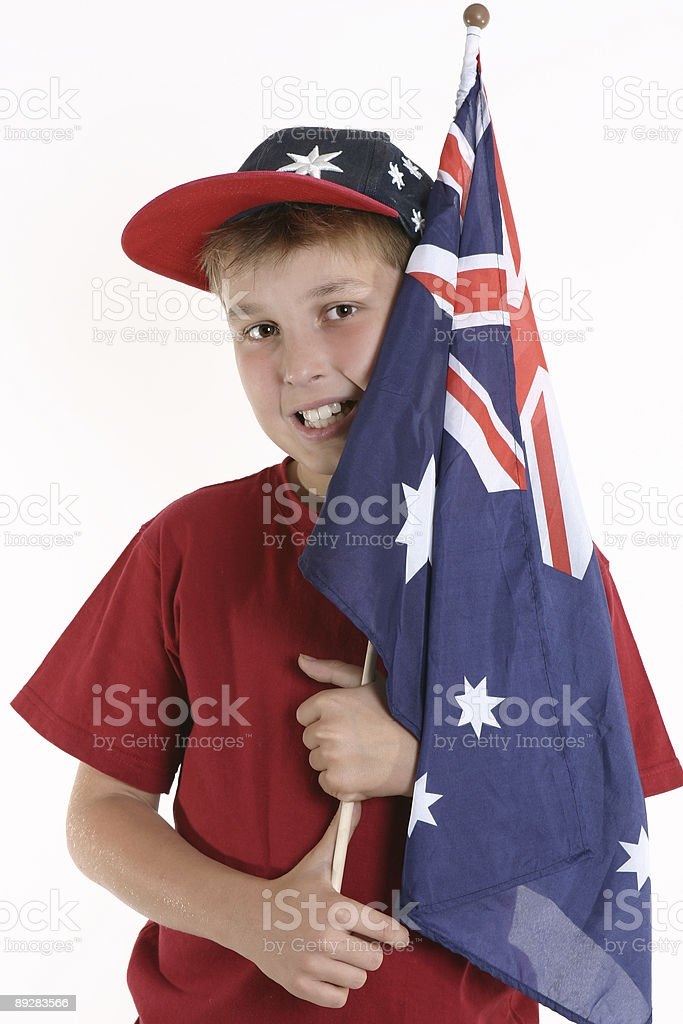 True Blue - Patriotic boy holding australian flag stock photo