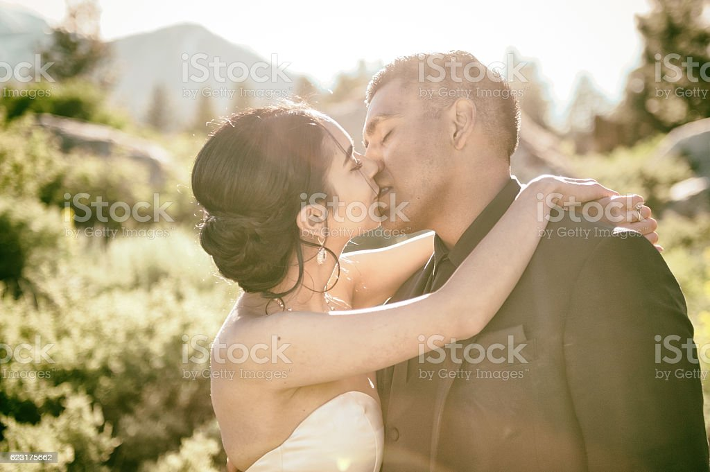 True Love kiss after wedding in the Mountains stock photo