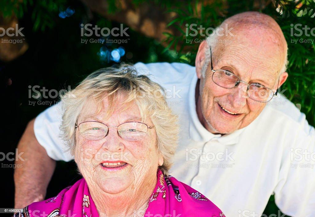 True love lasts! Happy senior couple smile stock photo