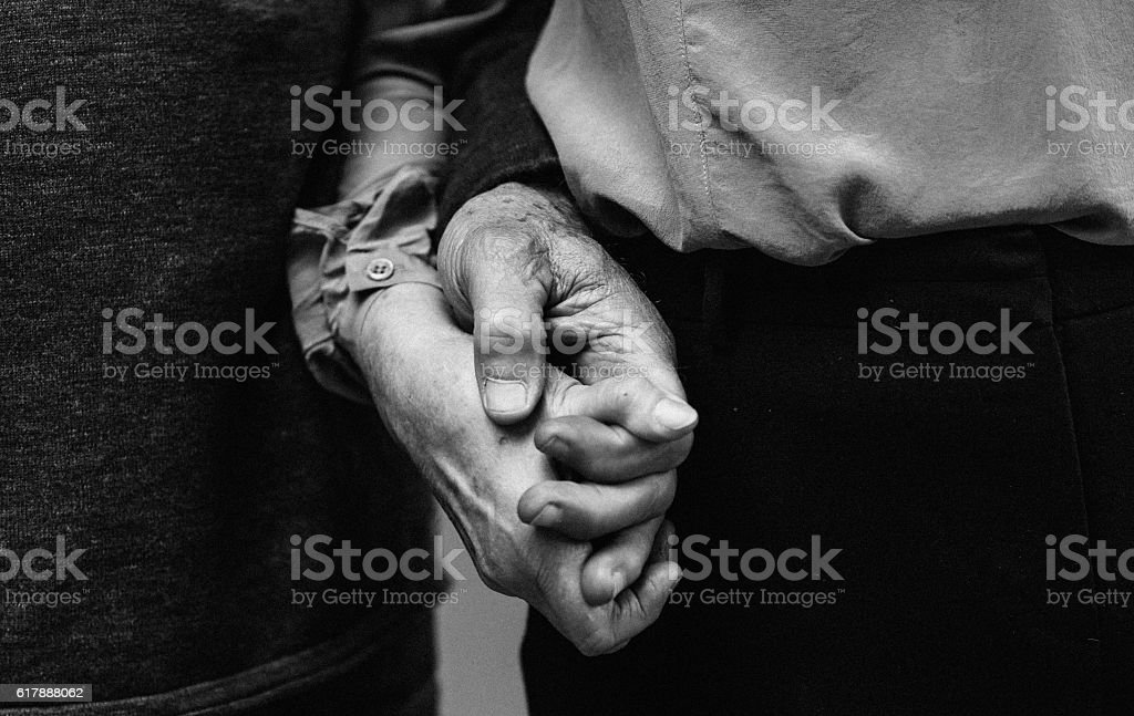 True Love - Old couple holding hands stock photo