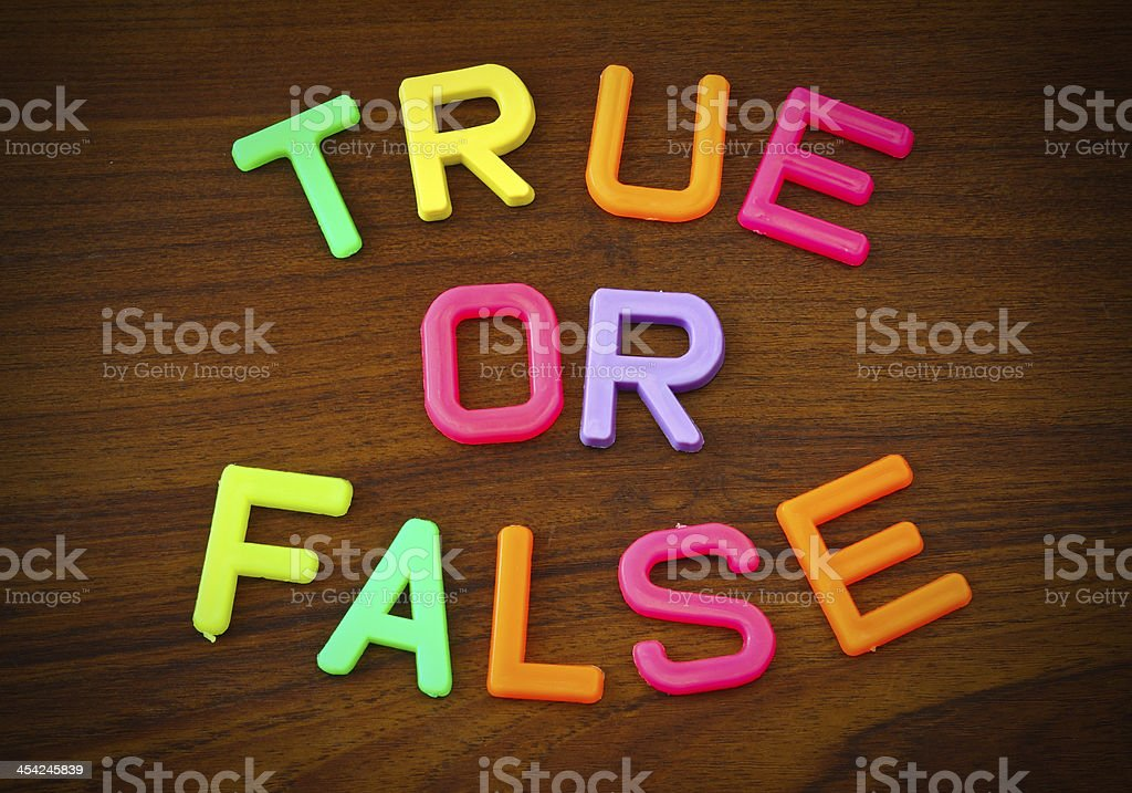 True or false in colorful toy letters on wood background royalty-free stock photo