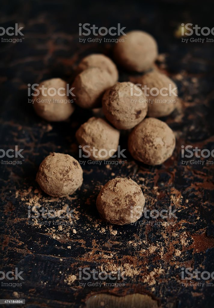 truffle candy on a dark vintage surface stock photo