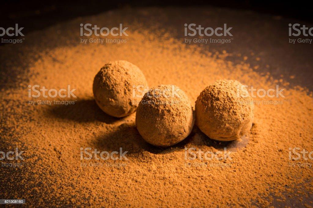 Truffle chocolate candies on cocoa powder. Best chocolate truffles stock photo