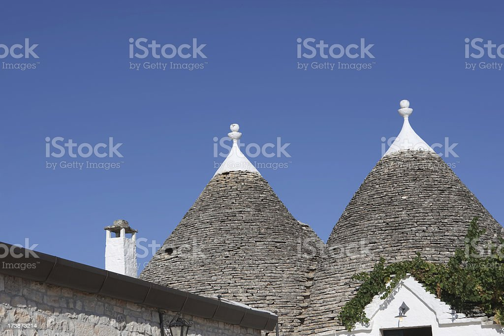 Trulli houses with their typical conical roofs in Alberobello, Italy stock photo