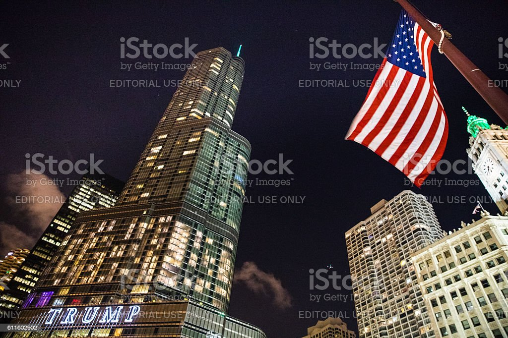 Trump Tower and USA flag in downtown Chicago stock photo