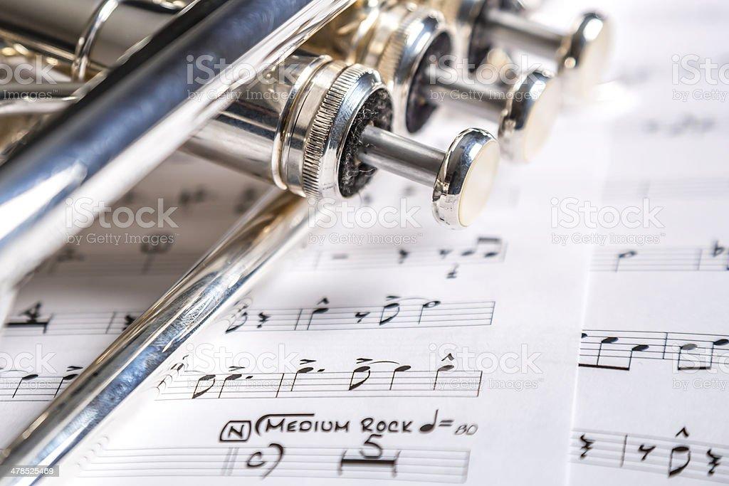 Trumpet closeup with music sheet stock photo