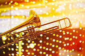 Trumpet in musical lights abstract background