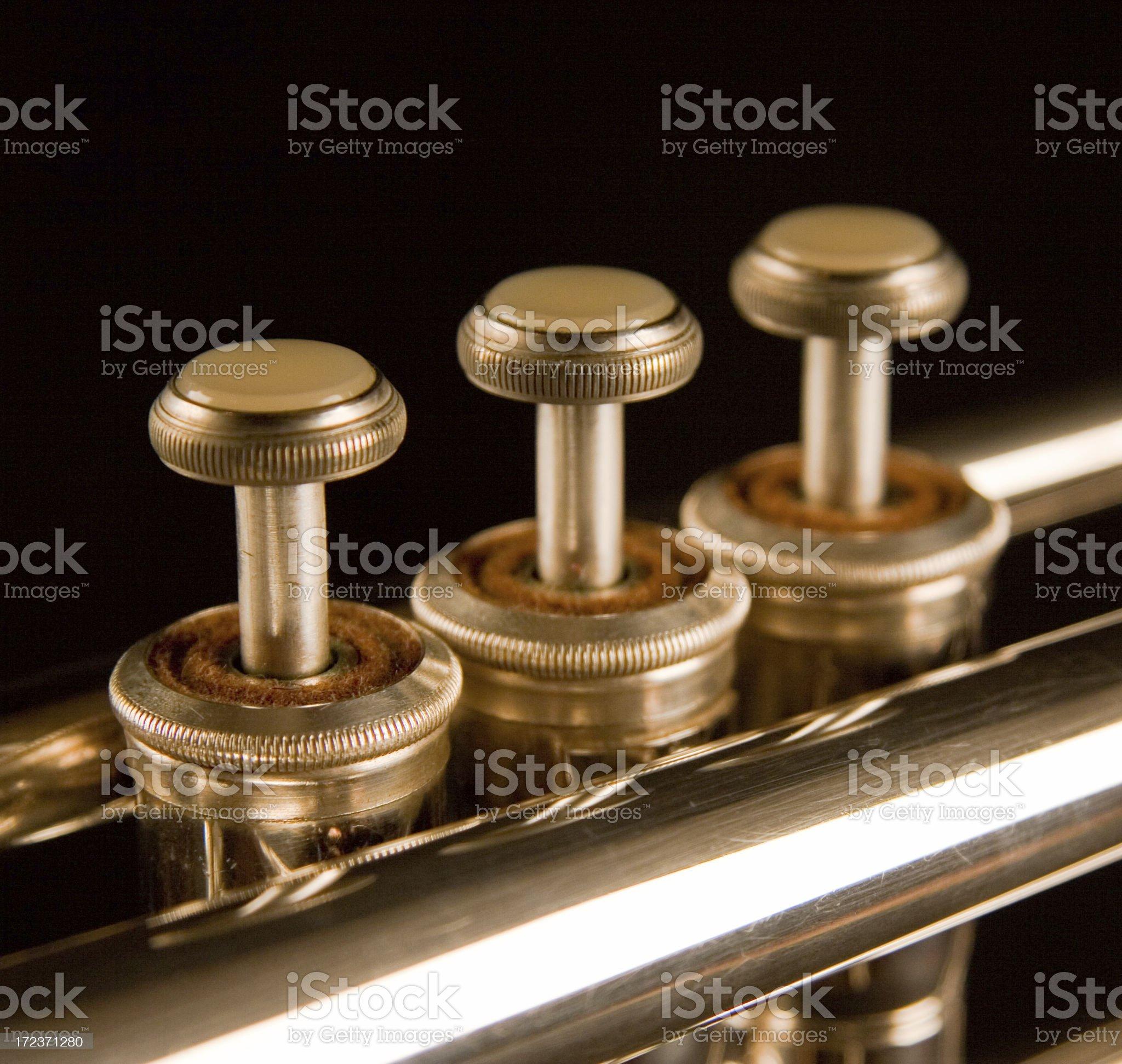 Trumpet keys on a blackground royalty-free stock photo