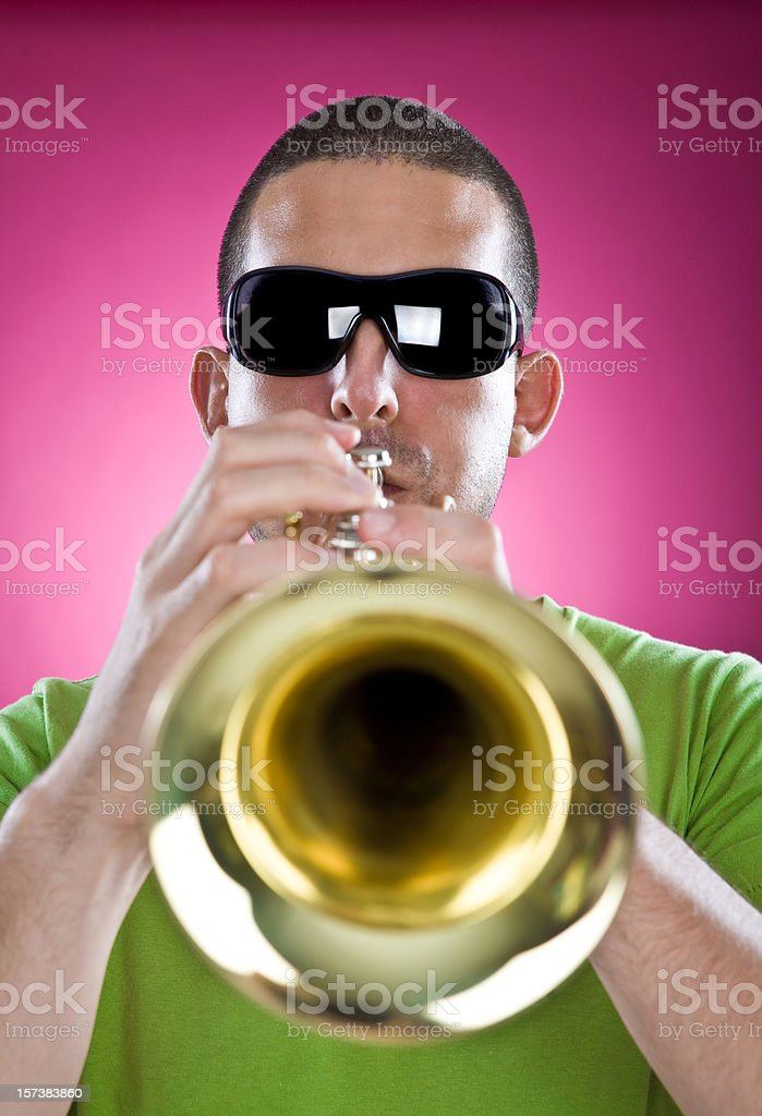 trumpet man musician play on pink background royalty-free stock photo