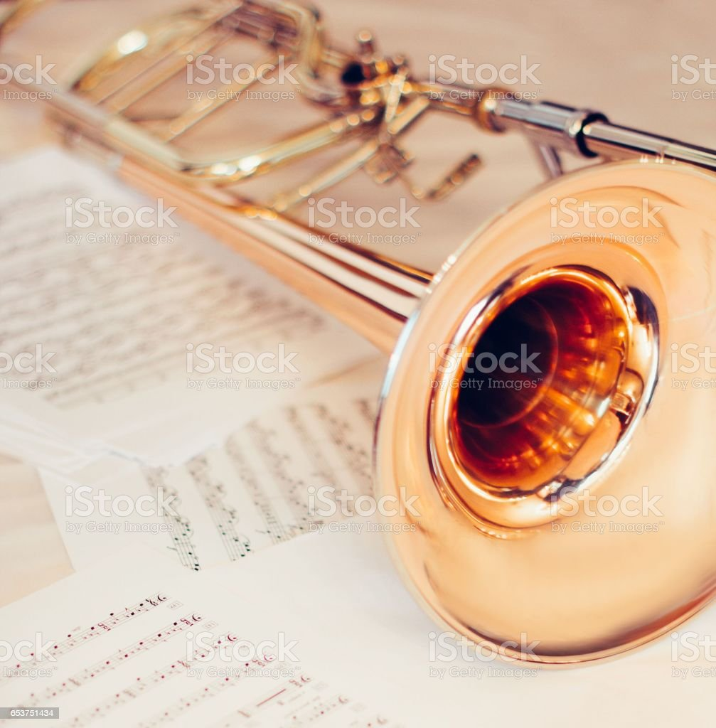Trumpet on music scores music concept background stock photo
