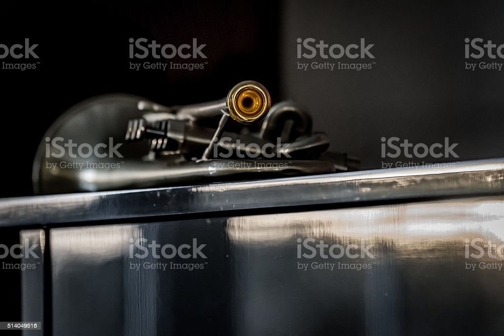 Trumpet on piano stock photo