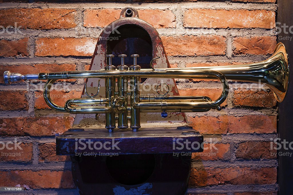 Trumpet on the mechanical parts royalty-free stock photo
