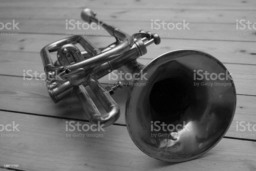 Trumpet on wood floor royalty-free stock photo