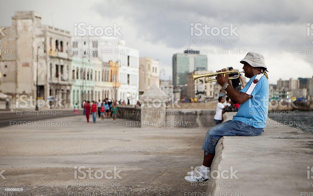 Trumpet player on the Malecon, Havana, Cuba. stock photo