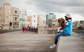 Trumpet player on the Malecon, Havana, Cuba.