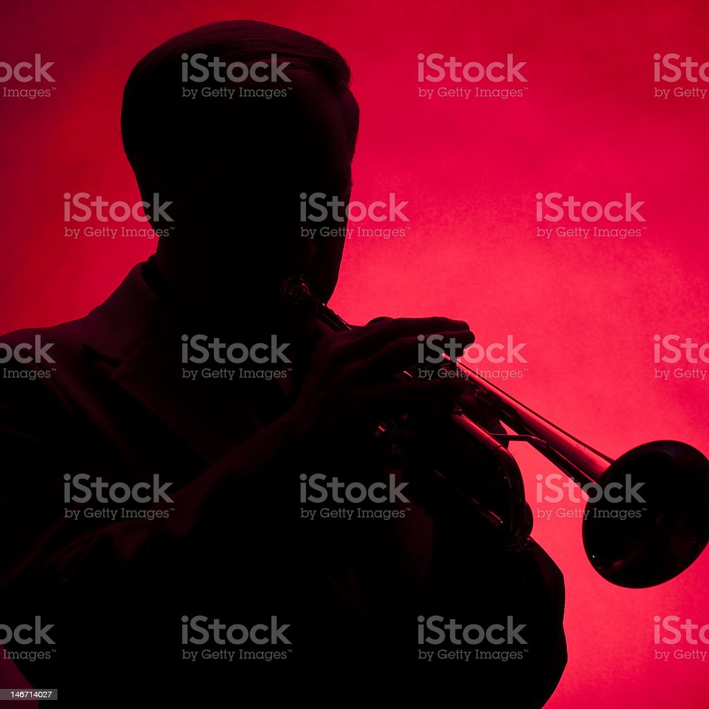 Trumpet Player Silhouette Red royalty-free stock photo