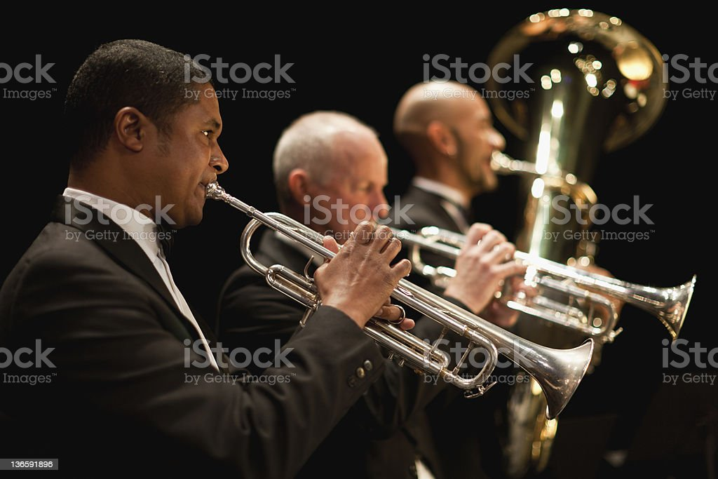 Trumpet players in orchestra stock photo