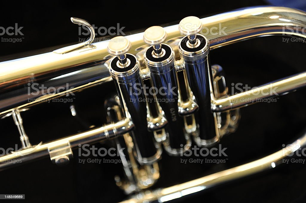 trumpet playing time stock photo