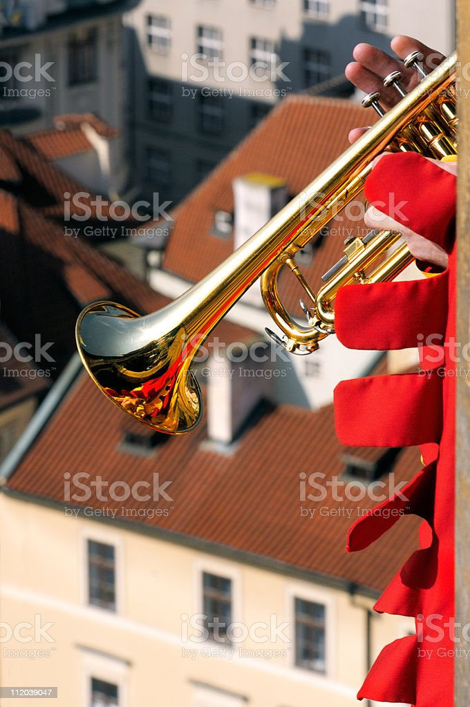 Trumpet plays from the Town Hall Tower in Prague royalty-free stock photo