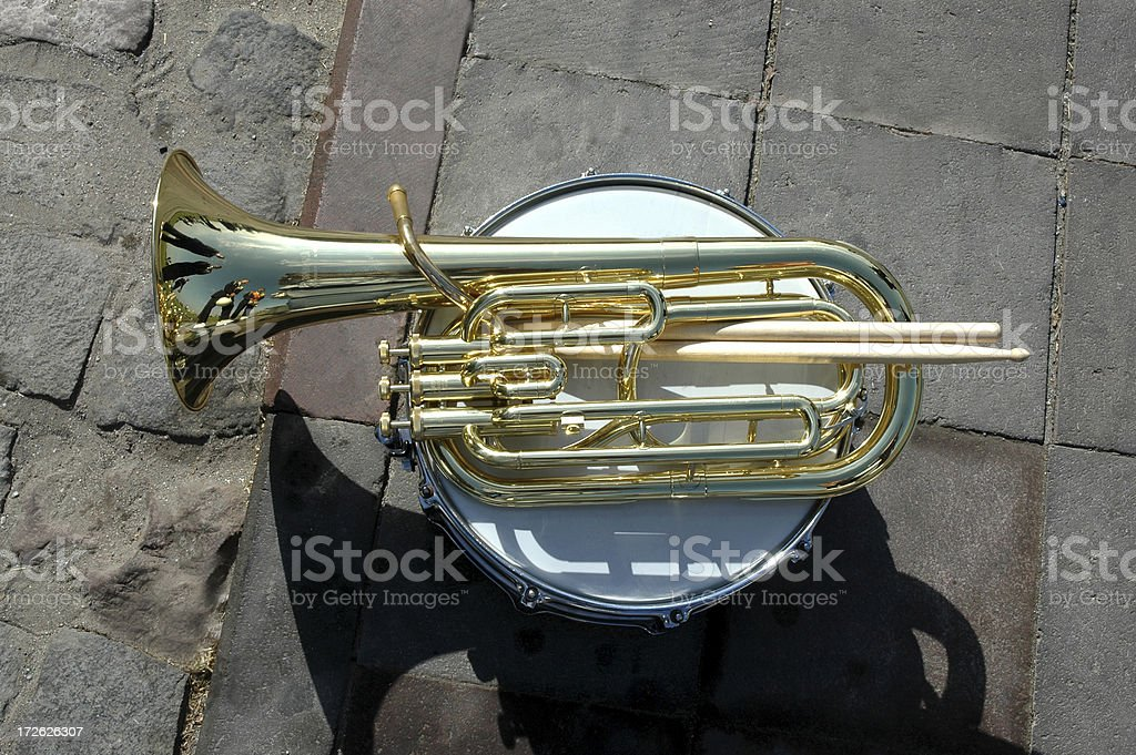 trumpet,drumsticks,trampet on the sidewalk(musical instruments) royalty-free stock photo