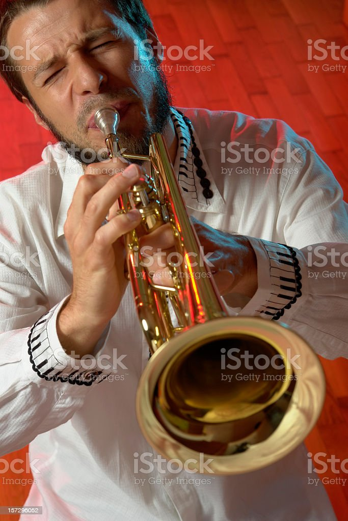 Trumpeter, musician with golden trumpet is playing classical jazz music stock photo