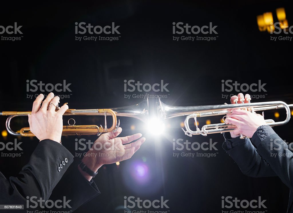 Trumpeters playing trumpet vis a vis stock photo