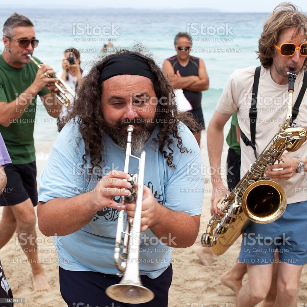 Trumpets and Saxophone on The Beach stock photo