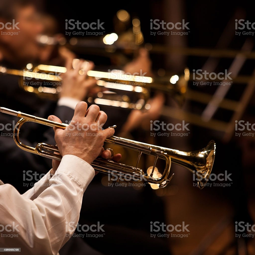 Trumpets in the hands of the musicians stock photo