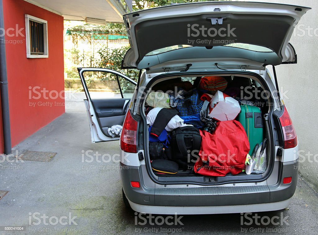 trunk of the car overloaded with bags and luggage stock photo
