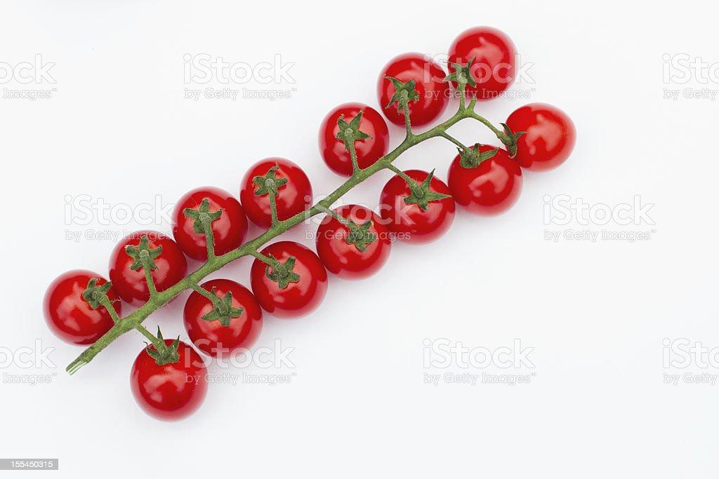 truss of cherry tomatoes stock photo