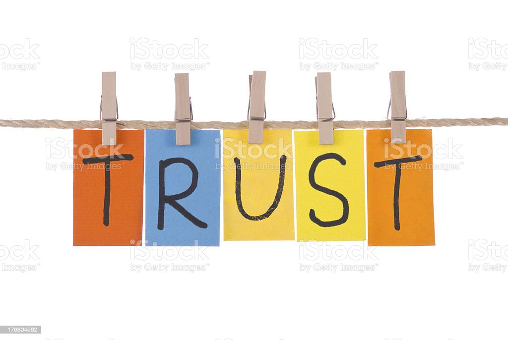 Trust, Colorful words hang on rope by wooden peg royalty-free stock photo